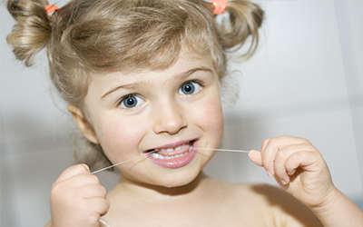 Teaching Your Kids To Floss